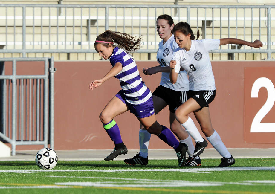 "Port Neches-Groves' Hannah Higgins, No. 6, pulls away from Galena Park's Merilyn Duarte, No. 16, and Trinity Herrera, No. 9, as she pushes the ball up the field Friday. The Port Neches-Groves Indian girls soccer team played against Galena Park Yellowjackets at the Carrol A. ""Butch"" Thomas Educational Support Center on Friday. Photo taken Friday 3/27/15 Jake Daniels/The Enterprise Photo: Jake Daniels / ©2015 The Beaumont Enterprise/Jake Daniels"