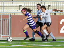 "Port Neches-Groves' Hannah Higgins, No. 6, pulls away from Galena Park's Merilyn Duarte, No. 16, and Trinity Herrera, No. 9, as she pushes the ball up the field Friday. The Port Neches-Groves Indian girls soccer team played against Galena Park Yellowjackets at the Carrol A. ""Butch"" Thomas Educational Support Center on Friday. Photo taken Friday 3/27/15 Jake Daniels/The Enterprise"