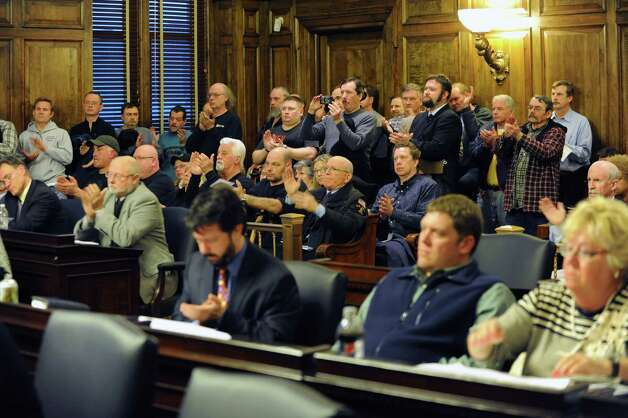 People applaud a speaker against the SAFE act at the Albany County Legislature meeting at the Albany Courthouse on Monday March 11, 2013 in Albany, N.Y.  (Lori Van Buren / Times Union) Photo: Lori Van Buren / 00021508A