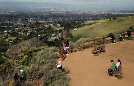 Hikers enjpy the view from the Eagle Rock lookout along the North Rim Trail at Alum Rock Park, as seen on Sat. March 28, 2015, in San Jose, Calif.