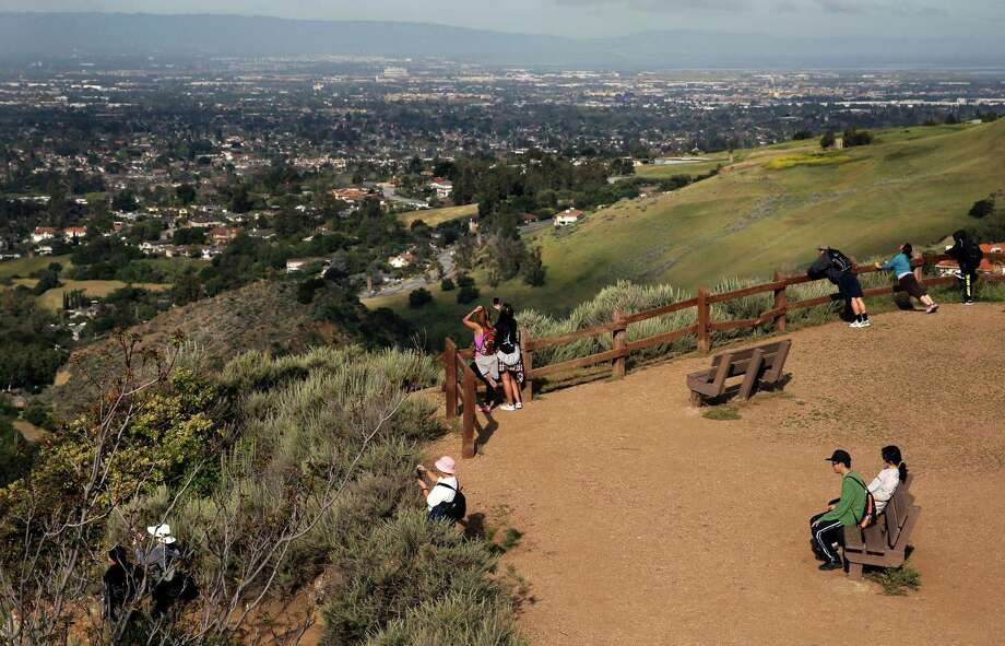 Hikers enjpy the view from the Eagle Rock lookout along the North Rim Trail at Alum Rock Park, as seen on Sat. March 28, 2015, in San Jose, Calif. Photo: Michael Macor / The Chronicle / ONLINE_YES