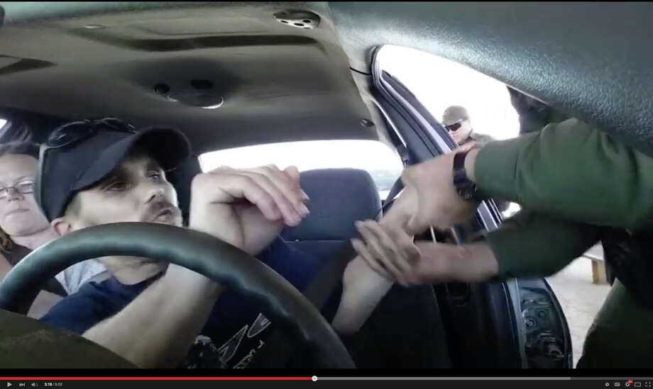 This is a frame grab of a video recorded by people dealing with Border Patrol upon entering the U.S. They say that the man was forcibly removed from his vehicle after refusing to answer questions. Photo: Youtube.com / Youtube.com