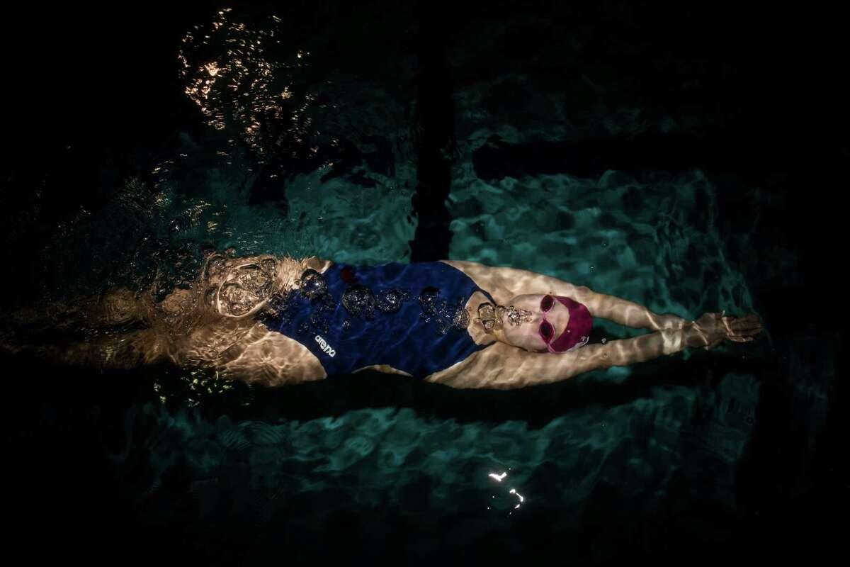 Marian Yurchishin, 17, the 2015 Express-News girl swimmer of the year, poses for a portrait at Josh Davis Natatorium in San Antonio, TX on Thursday, March 26, 2015.