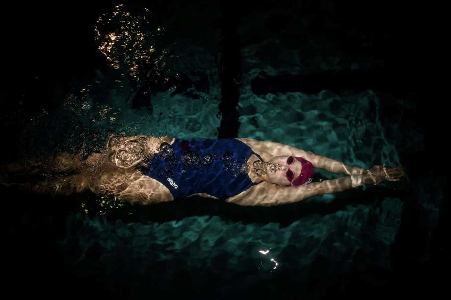 Marian Yurchishin, 17, the 2015 Express-News girl swimmer of the year, poses for a portrait at Josh Davis Natatorium in San Antonio, TX on Thursday, March 26, 2015. Photo: Carolyn Van Houten, Staff / San Antonio Express-News / 2015 San Antonio Express-News