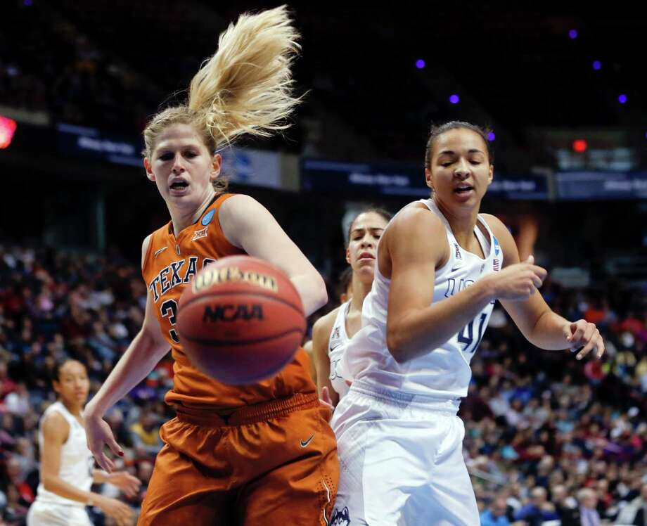 Texas forward Sara Hattis, left, and Connecticut center Kiah Stokes battle for the ball during the second half of a women's college basketball regional semifinal game in the NCAA Tournament on Saturday, March 28, 2015, in Albany, N.Y. UConn won 105-54. (AP Photo/Mike Groll) Photo: Mike Groll, STF / Associated Press / AP