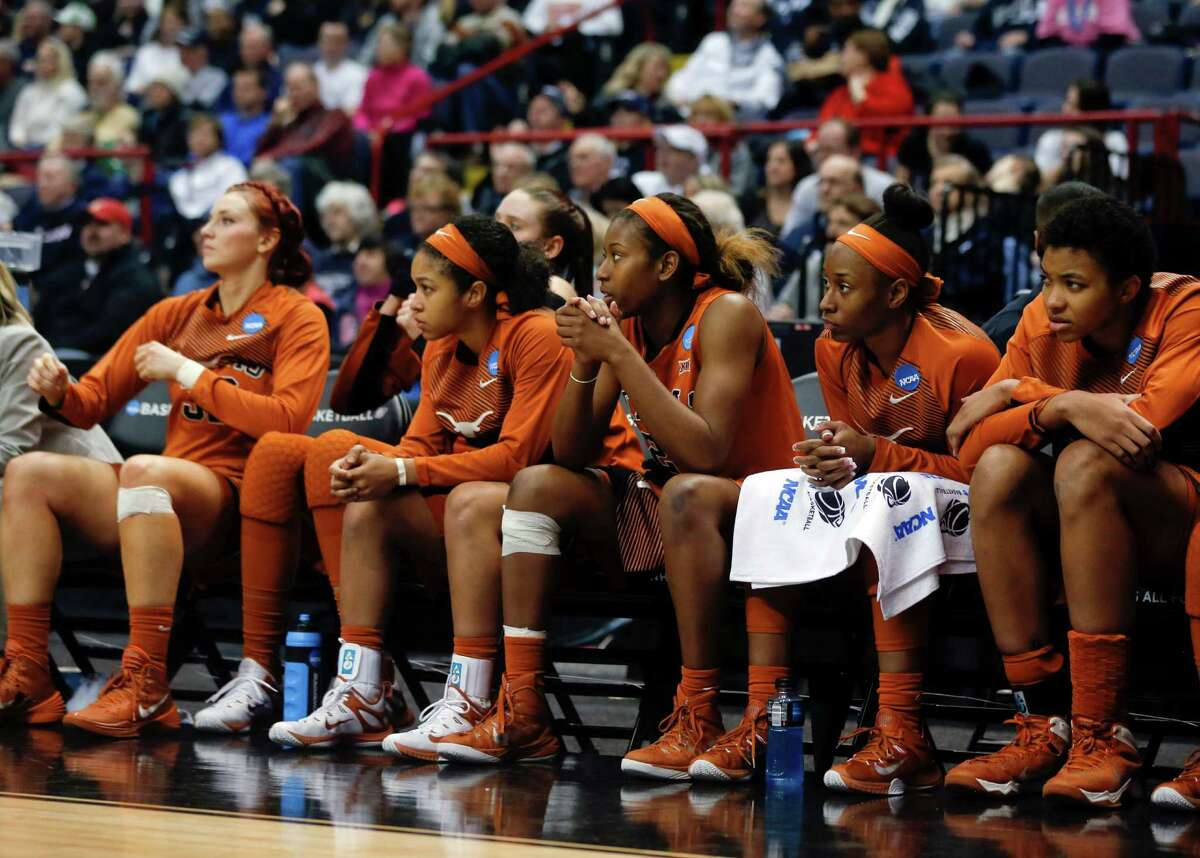 Texas players sit on the bench near the end of their 105-54 loss to Connecticut in a women's college basketball regional semifinal game in the NCAA Tournament on Saturday, March 28, 2015, in Albany, N.Y. (AP Photo/Mike Groll)