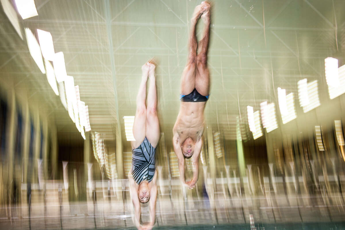 John Marshall High School divers Christopher Law and Giovanna Accioly pose for a portrait during a practice in San Antonio, Tx. on Wednesday, March 25, 2015. Both seniors have earned scholarships to dive next year, Law at Ohio State University and Accioly at University of the Incarnate Word.