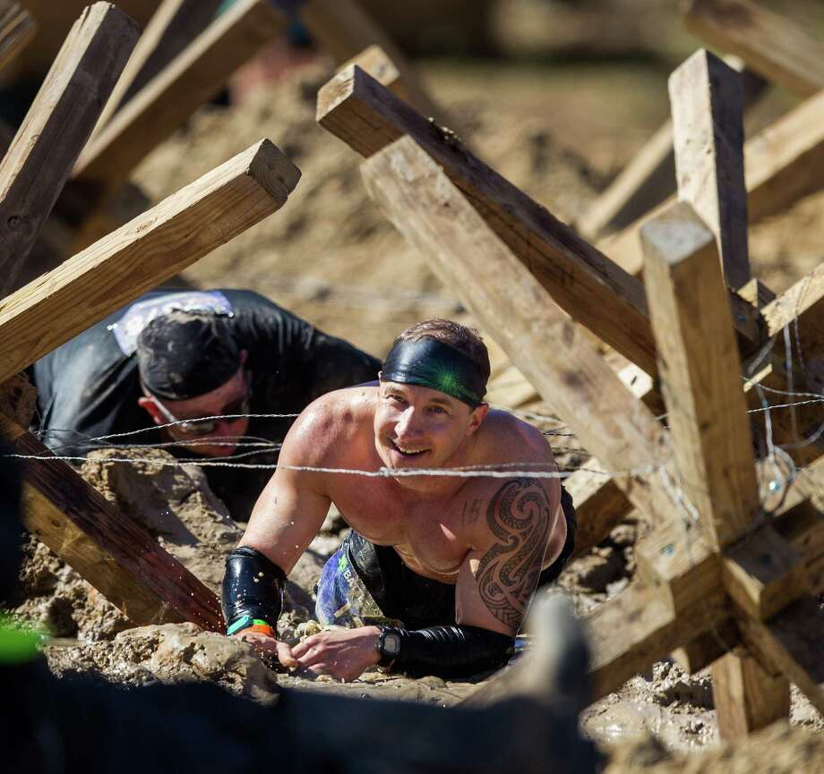 Participants run through different  obstacles during the Battlefrog Obstacle Race Series on Saturday, March 28, 2015. Photo: Bob Levey, Houston Chronicle / ©2015 Bob Levey