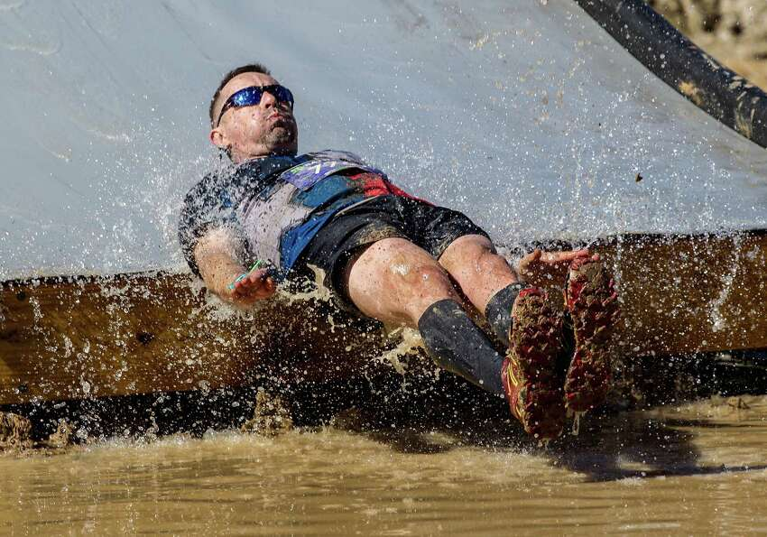Participants run through different obstacles during the Battlefrog Obstacle Race Series on Saturday, March 28, 2015.
