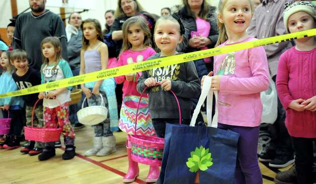 Children and their parents line up for the start of the Annual Cohoes Easter Egg Hunt on Saturday, March 28, 2015, at Cohoes Community Center in Cohoes, N.Y. (Cindy Schultz / Times Union) Photo: Cindy Schultz / 00031212A