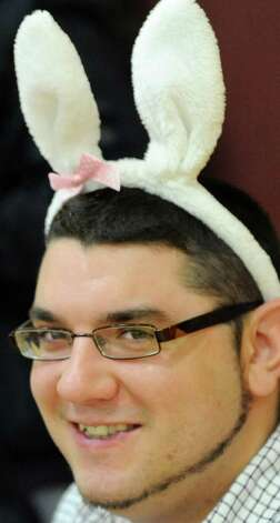 Justin Spencer of Cohoes tries on a pair of bunny ears during the Annual Cohoes Easter Egg Hunt on Saturday, March 28, 2015, at Cohoes Community Center in Cohoes, N.Y. (Cindy Schultz / Times Union) Photo: Cindy Schultz / 00031212A