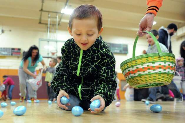 Gage Saunders, 4, of Cohoes collects plastic eggs filled with candy or tickets for prizes during the Annual Cohoes Easter Egg Hunt on Saturday, March 28, 2015, at Cohoes Community Center in Cohoes, N.Y. (Cindy Schultz / Times Union) Photo: Cindy Schultz / 00031212A