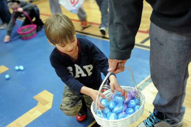 Nicholas Garneau, 4, of Cohoes collects plastic eggs filled with candy or tickets for prizes during the Annual Cohoes Easter Egg Hunt on Saturday, March 28, 2015, at Cohoes Community Center in Cohoes, N.Y. (Cindy Schultz / Times Union) Photo: Cindy Schultz / 00031212A