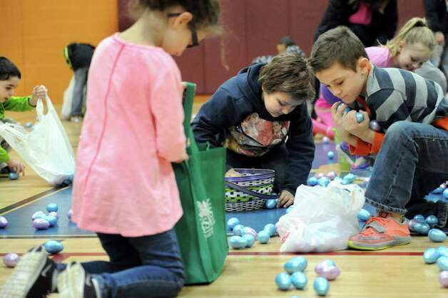 Children collect plastic eggs filled with candy or tickets for prizes during the Annual Cohoes Easter Egg Hunt on Saturday, March 28, 2015, at Cohoes Community Center in Cohoes, N.Y. (Cindy Schultz / Times Union) Photo: Cindy Schultz / 00031212A