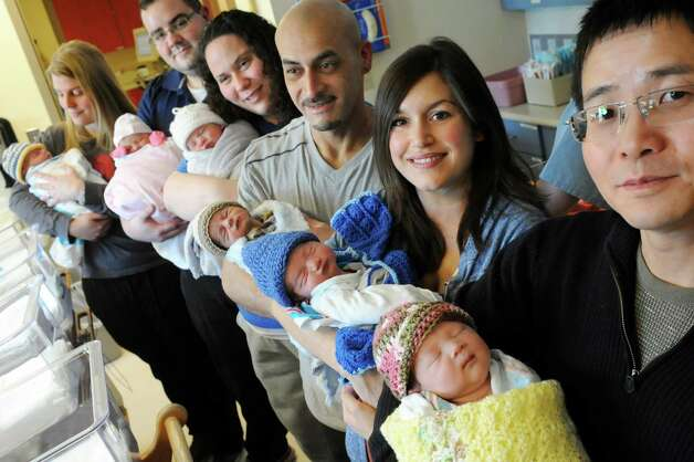 Parents hold their newborn babies in the nursery on Tuesday, March 24, 2015, at Bellevue Woman's Hospital in Niskayuna, N.Y.  From left are Amanda Madigan of Albany, Mike Jones of Niskayuna, Christine Winchip of Ballston Spa, Jose Rodriguez of Schenectady, Corinna Schinnerer of Ballston Lake and Juntao Wu of Niskayuna. (Cindy Schultz / Times Union) Photo: Cindy Schultz / 00031160A