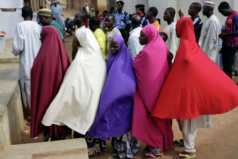 Nigerians wait for to register Saturday before voting in Jere, 40 miles from the capital of Abuja. The election pits a Christian incumbent versus a Muslim challenger. Photo: Jerome Delay, STF / AP