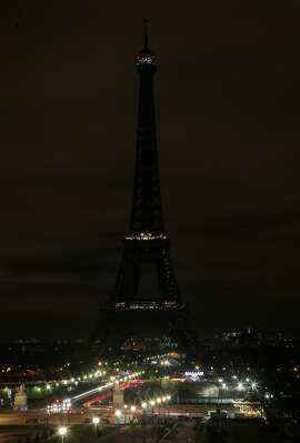 A picture taken on March 28, 2015 in Paris shows the Eiffel Tower being submerged into darkness for the Earth Hour environmental campaign. Millions are expected to take part around the world in the annual event organised by conservation group WWF, with hundreds of well-known sights set to plunge into darkness. AFP PHOTO JACQUES DEMARTHONJACQUES DEMARTHON/AFP/Getty Images