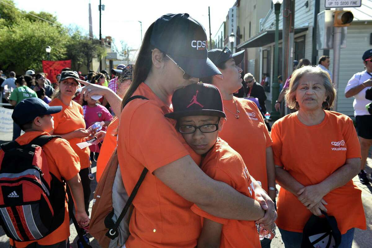 Melinda Solis hugs her son Nathaniel Soto during the annual César Chávez March for Justice from the West Side to the Alamo.