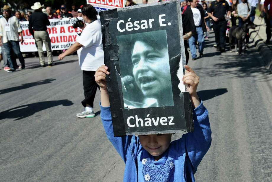 Madison Valaquez, 7, holds a César Chávez poster during the annual César Chávez March for Justice from the West Side to the Alamo. Photo: Matthew Busch /For The Express-News / © Matthew Busch