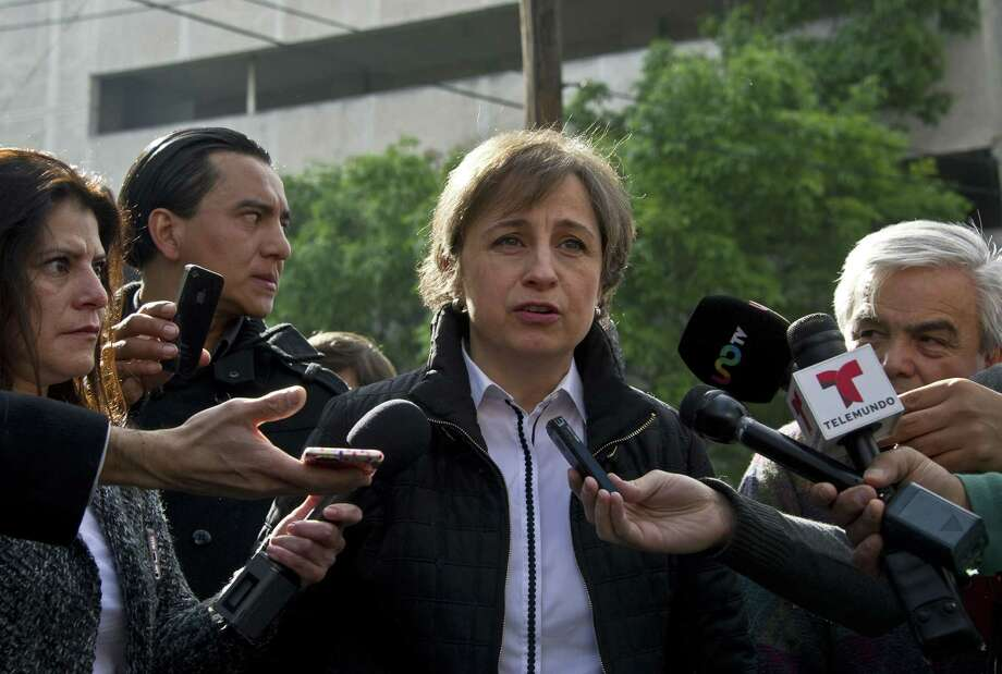 Carmen Aristegui speaks to the press in Mexico City on March 16, a day after being fired. She is a broadcast journalist whose report about the first lady's mansion caused a scandal. Photo: Ronaldo Schemidt / Getty Images / AFP