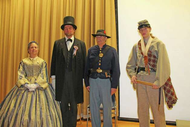 Peter Lindemann portrays President Lincoln, Judee Synakowski portrays Mary Todd Lincoln, Howard Young is a Union soldier and RCS sudent Matt LaFave portrays a Confederate soldier at a Thursday, March 26, commemoration at the school  of the 150th anniversary of the end of the Civil War. (Submitted by Sabre Sarnataro)