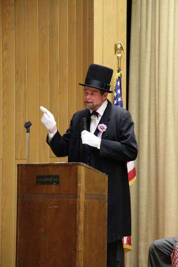 Peter Lindemann portrays President Lincoln at a Thursday, March 26, commemoration at the school  of