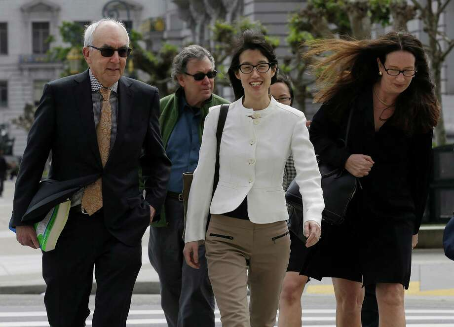Ellen Pao, center, walks to Civic Center Courthouse in San Francisco, Friday, March 27, 2015. The jury are due back in court on Friday in Pao's lawsuit against Kleiner Perkins Caufield & Byers. Pao says the firm discriminated against her because she was a woman and then retaliated by denying her a promotion and firing her when she complained about gender bias. Kleiner Perkins denies the allegations. (AP Photo/Jeff Chiu) Photo: Jeff Chiu, STF / AP