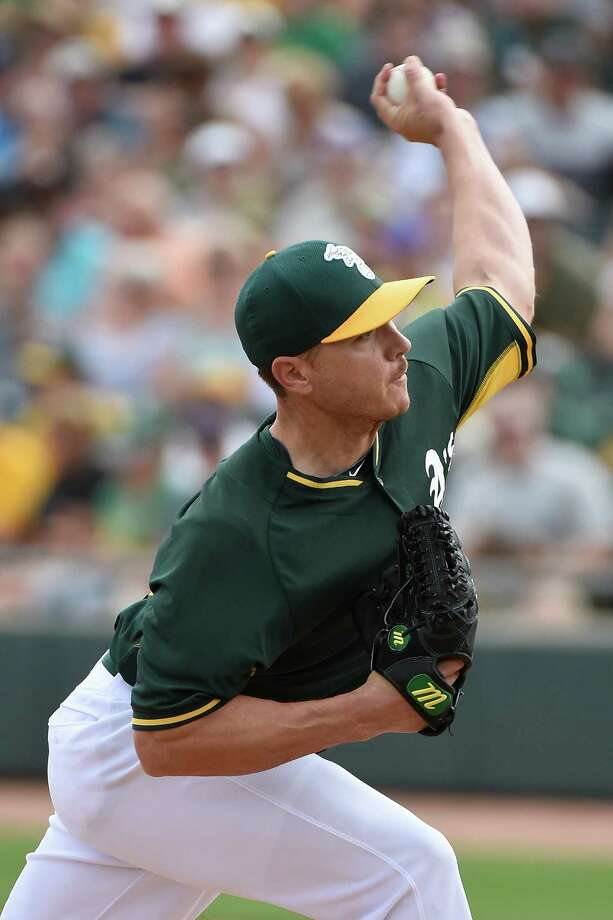 MESA, AZ - MARCH 12:  Scott Kazmir #26 of the Oakland Athletics pitches against the Seattle Mariners at HoHoKam Stadium on March 12, 2015 in Mesa, Arizona.  (Photo by Lisa Blumenfeld/Getty Images) Photo: Lisa Blumenfeld / Getty Images / 2015 Getty Images