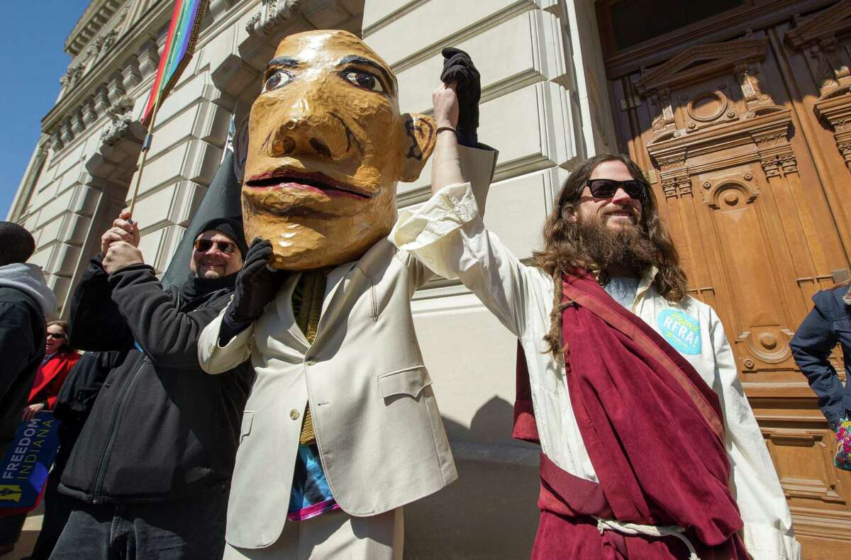 A pair of impersonators take part in Saturday's protest against Indiana's Religious Freedom Restoration Act. The protesters say the new law makes religious bigotry toward gays and lesbians legal.