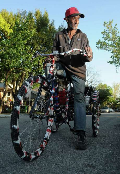 Richard Perry check out his new tricycle outside The Station on W. 11th in the Heights Tuesday March 24, 2015. The bike was donated by neighbors after his last bike was stolen.(Dave Rossman photo) Photo: Dave Rossman, Freelance / Freelalnce