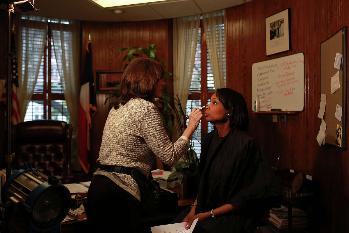 Mayor Ivy Taylor has her makeup done by Carrie Harrell before being filmed for a video about Renee Watson, for an award Watson won, on Tuesday, March 17, 2015. Harrell was working with the film crew from Shootz Production Group.
