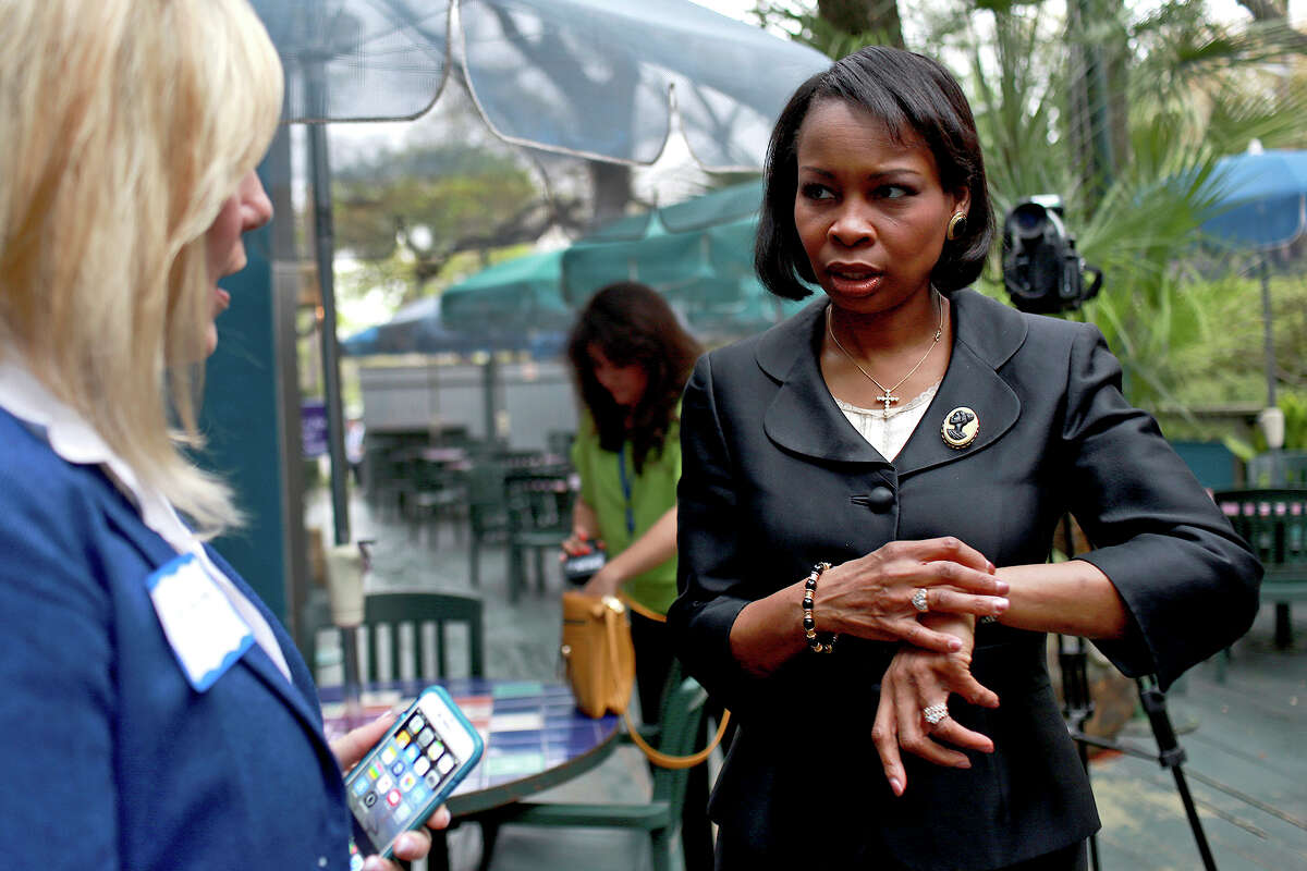 Mayor Ivy Taylor checks the time between events with Chief of Staff Jill DeYoung, left, on Tuesday, March 17, 2015.