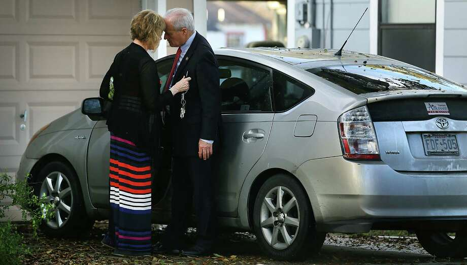 """County Commissioner Tommy Adkisson and his wife Karen Barbee Adkisson give their personal """"head bonk"""" as he leaves home on a busy campaigning day.  Wednesday, March 18, 2015. Photo: Bob Owen, Staff / © 2015 San Antonio Express-News"""