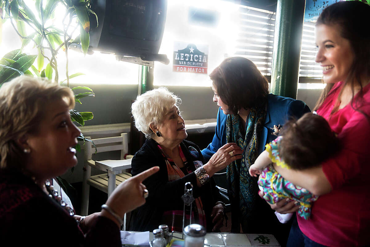 Leticia Van de Putte talks to her mother Belle Ortiz, center, while Irene Sanchez-Ross, left, and Marina Alderete Gavito, holding her daughter Marielle Gavito, speak during a breakfast event for Van de Putte's campaign at Cha Cha's Restaurant in San Antonio, TX on Saturday, March 14, 2015.