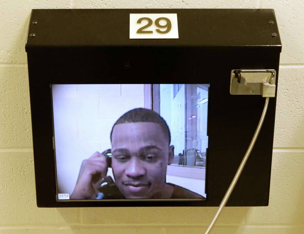 Neisha Dshawn Minger speaks via video to her boyfriend, Gerald Powell, who is being held at the Fort Bend County jail in Richmond.