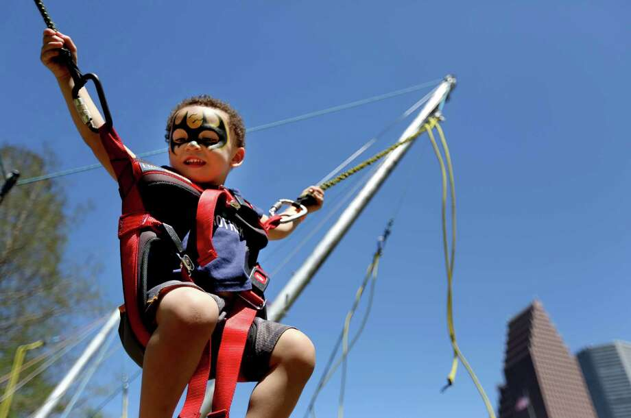 Cayson Jordon, 30-months, of Houston, rides the bungy bounce at the McDonald's Houston Children's Festival, the largest children's festival in the United States benefiting Child Advocates, Saturday, March 28, 2015, in Houston, Texas. The festival includes Disney and Nickelodeon celebrities, as well as 10 big Family Adventure Zones, six stages of entertainment and more than three hundred fun activities thru Sunday, March 29 from 10:30 a.m. until 6:30 p.m. Photo: Gary Coronado, Houston Chronicle / © 2015 Houston Chronicle