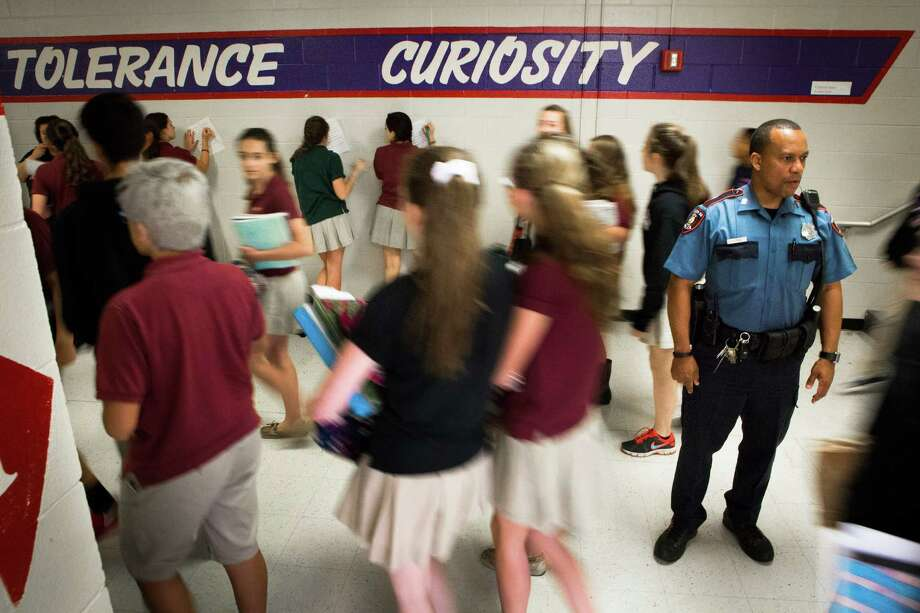 Houston ISD officer David Warren supervises eighth graders leaving the classrooms to go to the cafeteria at Lanier Middle School. He says he enjoys the job because he gets to be a positive influence on the students. Photo: Marie D. De Jesus, Staff / © 2015 Houston Chronicle