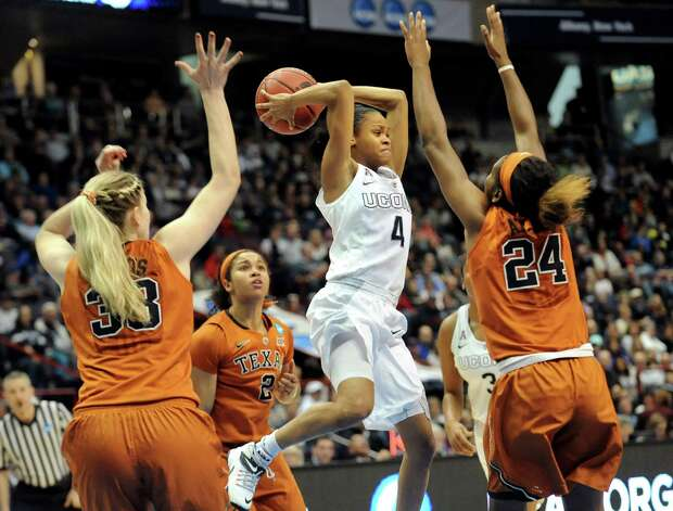 UConn's Moriah Jefferson, center, goes up to pass the ball during their NCAA women's tournament against Texas on Saturday, March 28, 2015, at Times Union Center in Albany, N.Y. (Cindy Schultz / Times Union) Photo: Cindy Schultz / 00031197A