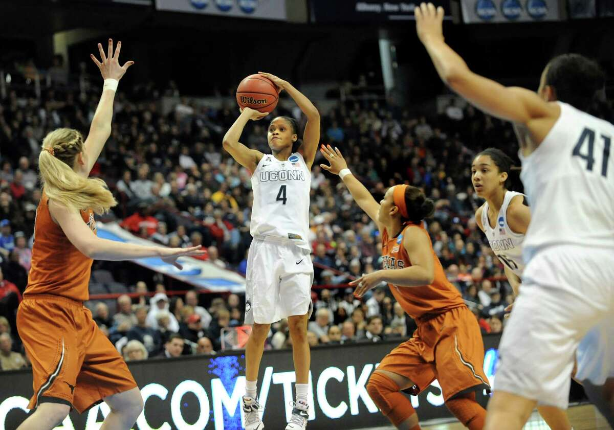 UConn's Moriah Jefferson, center, hits a 3-point shot during their NCAA women's tournament against Texas on Saturday, March 28, 2015, at Times Union Center in Albany, N.Y. (Cindy Schultz / Times Union)