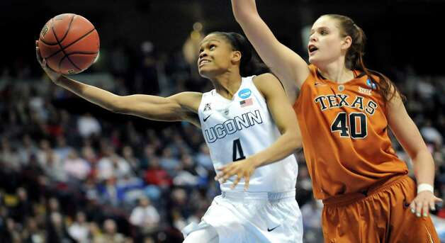 UConn's Moriah Jefferson, left, goes to the hoop as Texas' Kelsey Lang defends during their NCAA women's tournament against Texas on Saturday, March 28, 2015, at Times Union Center in Albany, N.Y. (Cindy Schultz / Times Union) Photo: Cindy Schultz / 00031197A