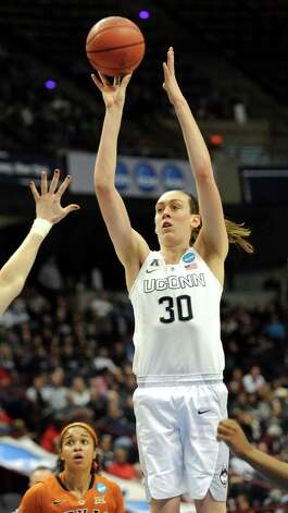 UConn's Breanna Stewart, center, hits a 3-point shot during their NCAA women's tournament against Texas on Saturday, March 28, 2015, at Times Union Center in Albany, N.Y. (Cindy Schultz / Times Union) Photo: Cindy Schultz / 00031197A