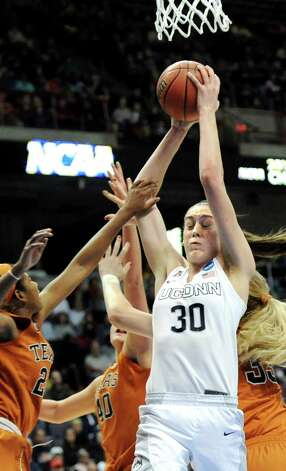 UConn's Breanna Stewart, center, wins a rebound during their NCAA women's tournament against Texas on Saturday, March 28, 2015, at Times Union Center in Albany, N.Y. (Cindy Schultz / Times Union) Photo: Cindy Schultz / 00031197A