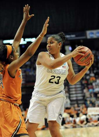 UConn's Kaleena Mosqueda-Lewis, right, looks to pass as Texas' Ariel Atkins defends during their NCAA women's tournament on Saturday, March 28, 2015, at Times Union Center in Albany, N.Y. (Cindy Schultz / Times Union) Photo: Cindy Schultz / 00031197A