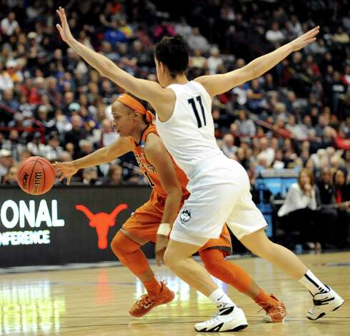 Texas' Empress Davenport, left, controls the ball as UConn's Kia Nurse defends during their NCAA women's tournament on Saturday, March 28, 2015, at Times Union Center in Albany, N.Y. (Cindy Schultz / Times Union) Photo: Cindy Schultz / 00031197A