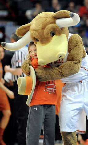 Bevo, the Texas Longhorn mascot, hugs a young basketball fan during their game against UConn in the NCAA women's tournament on Saturday, March 28, 2015, at Times Union Center in Albany, N.Y. (Cindy Schultz / Times Union) Photo: Cindy Schultz / 00031197A