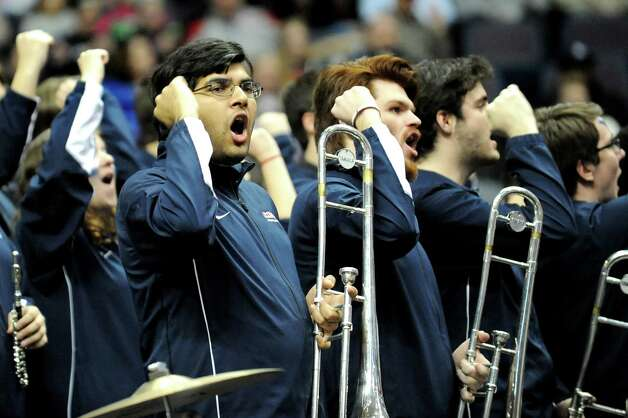 UConn's pep band cheers for their team during their game against Texas in the NCAA women's tournament on Saturday, March 28, 2015, at Times Union Center in Albany, N.Y. (Cindy Schultz / Times Union) Photo: Cindy Schultz / 00031197A