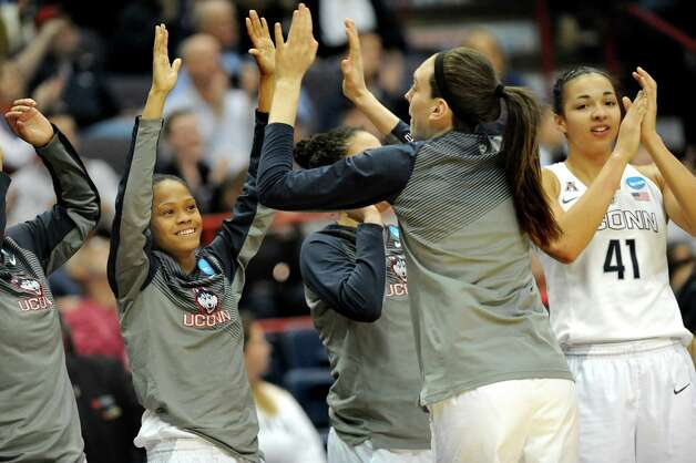 UConn's team celebrates their 105-54 win over Texas in the NCAA women's tournament on Saturday, March 28, 2015, at Times Union Center in Albany, N.Y. (Cindy Schultz / Times Union) Photo: Cindy Schultz / 00031197A