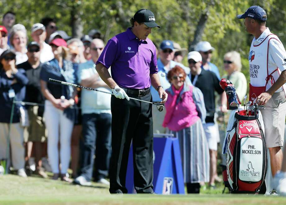 Phil Mickelson bounces a golf ball on his driver while awaiting to tee off from the No. 1 tee box during the 3rd round of the Valero Texas Open at TPC San Antonio on Saturday, Mar. 28, 2015. (Kin Man Hui/San Antonio Express-News) Photo: Kin Man Hui, Staff / San Antonio Express-News / ©2015 San Antonio Express-News