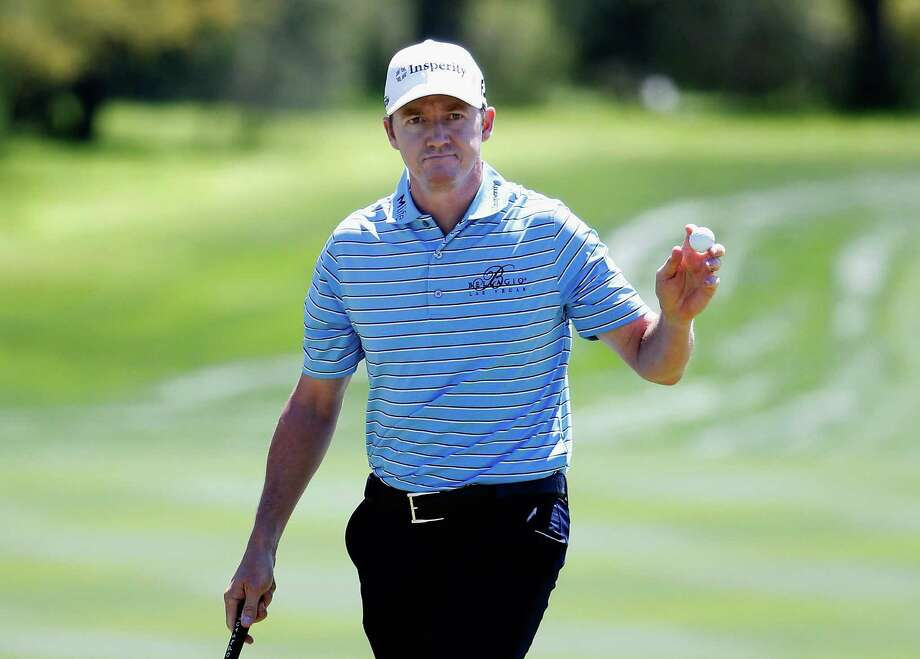 SAN ANTONIO, TX - MARCH 28:  Jimmy Walker reacts to his birdie putt on the eighth hole during round three of the Valero Texas Open at TPC San Antonio AT&T Oaks Course on March 28, 2015 in San Antonio, Texas.  (Photo by Christian Petersen/Getty Images) Photo: Christian Petersen, Staff / Getty Images / 2015 Getty Images