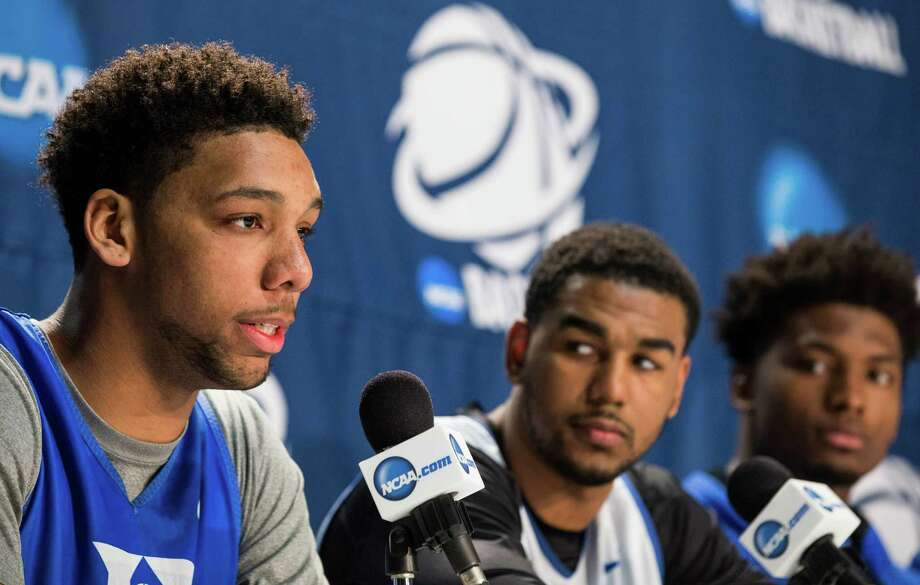 Duke center Jahlil Okafor, from left, guard Matt Jones and forward Justise Winslow meet the media Saturday at NRG Stadium. The Blue Devils will play Gonzaga in the South Region final at NRG Stadium today to determine which team advances to the Final Four. Photo: Brett Coomer, Houston Chronicle / © 2015 Houston Chronicle
